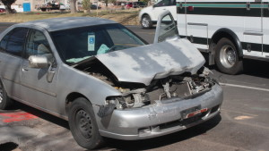The end result of a rear-end collision between a Nissan Altima and a black Mazda which occurred on Feb. 25, 2016. | Photo by Don Gilman, St. George News