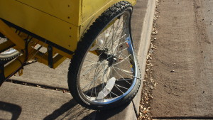 Damaged wheel on a tricycle that was damaged in a collision in St. George on Feb. 26, 2016. | Photo by Don Gilman, St. George News