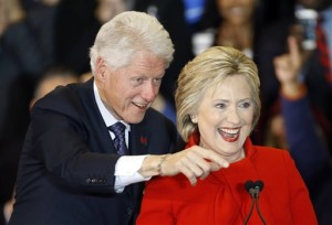 Former President Bill Clinton, left, and Democratic presidential candidate Hillary Clinton acknowledge supporters during a caucus night rally at Drake University, Des Moines, Iowa, Monday, Feb. 1, 2016.   AP Photo by Patrick Semansky, St. George News