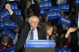 Democratic presidential candidate, Sen. Bernie Sanders, I-Vt, and his wave Jane acknowledge the crowd as he arrives for his caucus night rally, Des Moines, Iowa, Monday, Feb. 2, 2016 | AP Photo by Patrick Semansky