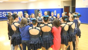 The Dixie High School Jetettes link hands and give an encouraging chant before taking the floor during halftime of the basketball game, St. George, Utah, February 12, 2016   Screenshot from video by Austin Peck, St. George News