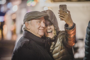 A couple pauses to take a selfie during Goerge Streetfest, St. George, Utah, January 1, 2016   Photo by Nick Adams courtesy of Emceesquare Media, Inc., St. George News