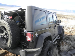 Black 2011 Jeep Wrangler, Milepost 85, North Interstate 15, Iron County, Utah | Photo courtesy of Utah Highway Patrol, St. George News