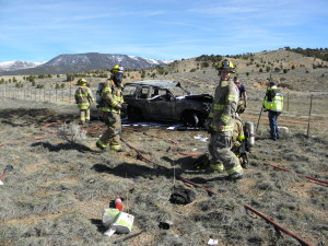 A car catches fire following a rollover authorities said was likely caused by a tire blowout. Cedar City, Utah, Feb. 27, 2016 | Photo courtesy of UHP Trooper Bambi Baie, St. George News / Cedar City News