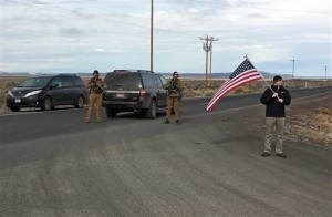 Armed law enforcement officers stand near a closed highway about 4 miles outside of the Malheur National Wildlife Refuge in Burns, Ore, after the last four occupiers of the national nature preserve surrendered on Thursday. The holdouts were the last remnants of a larger group that seized the wildlife refuge nearly six weeks ago, demanding that the government turn over the land to locals and release two ranchers imprisoned for setting fires. Burns, Oregon, Feb. 11, 2016 | Photo by Rebecca Boone(AP), St. George News