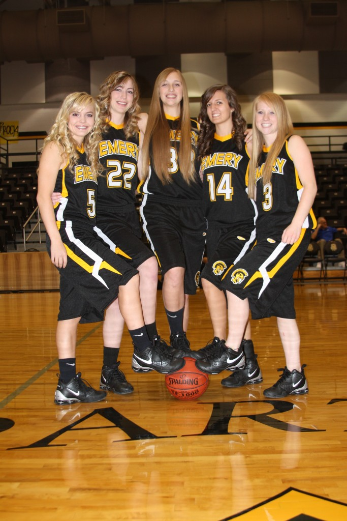 Taylor Mann (in the middle) with her state championship Emery High School team. | Photo courtesy Gordon