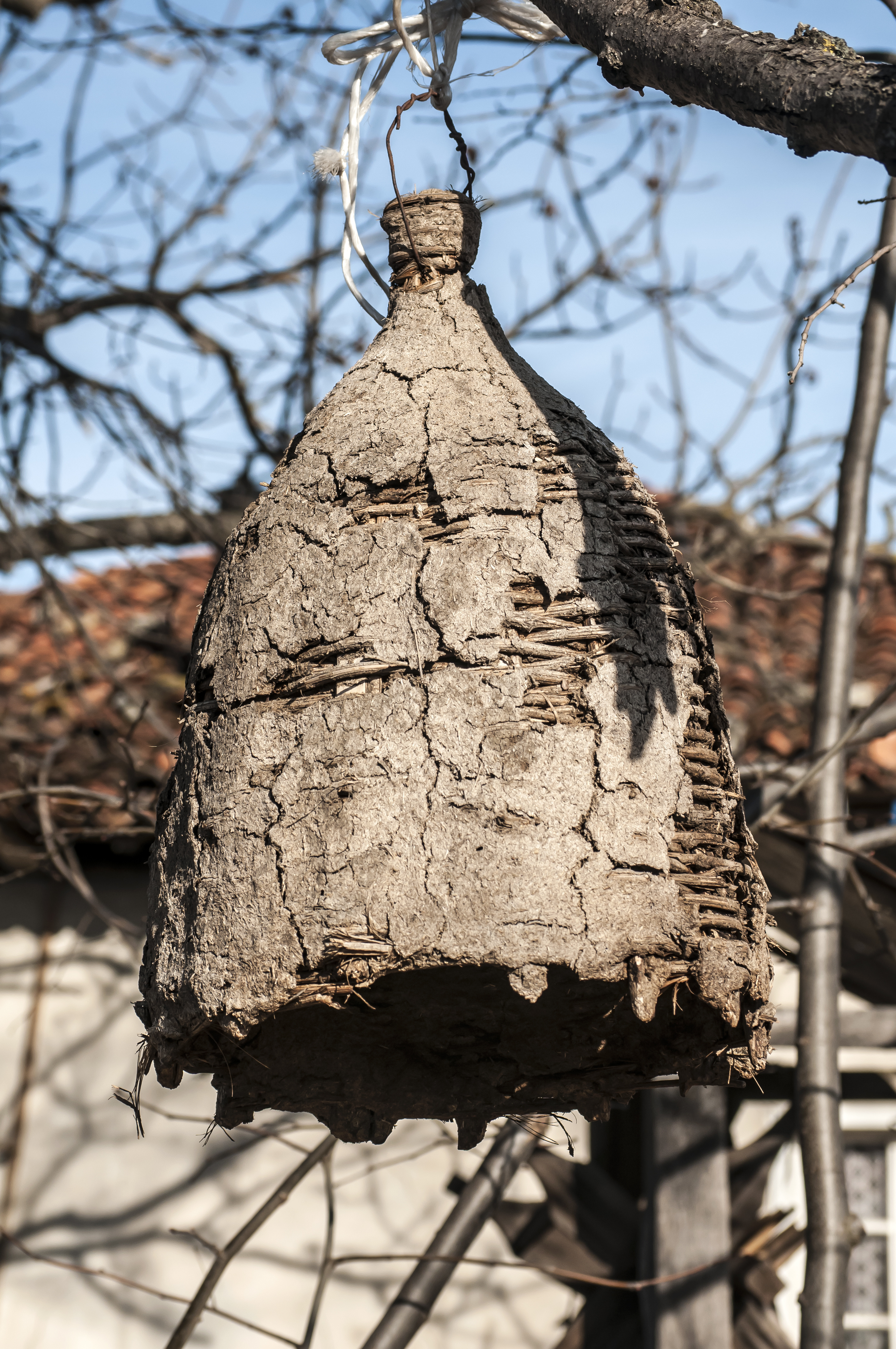 For illustration purposes: Old hanging beehive made of sticks and mud to capture wild bees | Stock image, St. George News