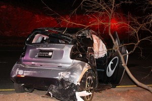 A single vehicle rollover on Red Hills Parkway Tuesday night looked scary, however the driver escaped with bumps and bruises. St. George, Utah, Feb. 23, 2016 | Photo by Ric Wayman, St. George News
