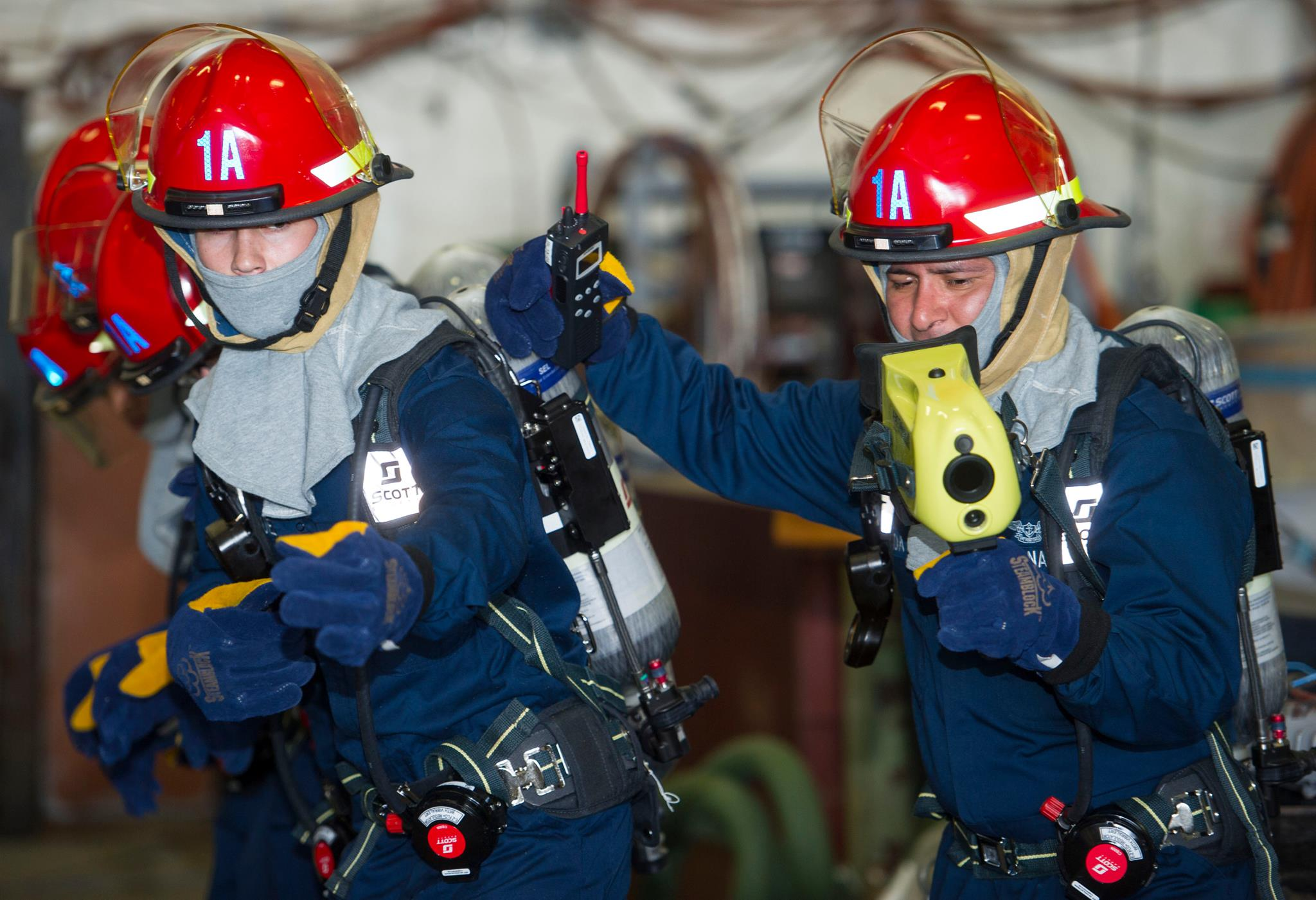 Sailors learn how to properly fight a fire during a general quarters drill aboard Pre-Commissioning Unit Gerald R. Ford (CVN 78). This ship-wide general quarters drill focused on damage control and emergency responses. Newport News, Virginia, March 10, 2016 | U.S. Navy photo by Mass Communication Specialist 2nd Class Ryan Litzenberger/Released, via USS Gerald R. Ford - CVN 78 - via Facebook page; St. George News