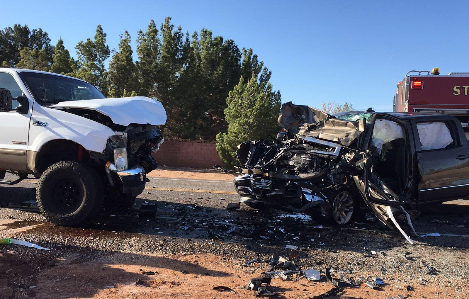 White Ford F-350 and brown Chevrolet Silverado after head on collision on Pioneer Road, St. George, Utah, Mar. 24, 2016| Photo courtesy of the St. George Police Department, St. George News