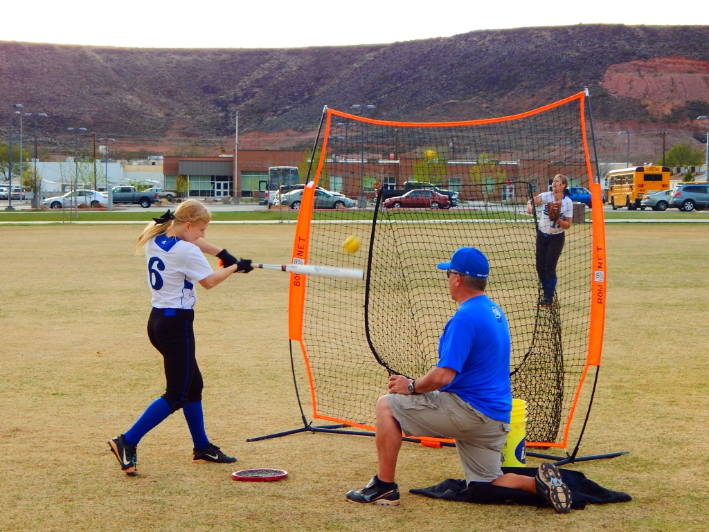 Dixie coach Dave Demas works with Hannah Nyberg before their games Friday at DHS, St. George, Utah, Mar. 11, 2016 | Photo by Shelly Griffin, special to St. George News