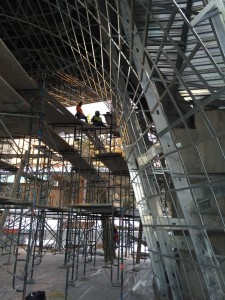 Construction workers sit atop scaffolding completing the metal work under the patio of the new museum, Cedar City, Utah, Date unspecified | Courtesy of Friends of SUMA, St. George News