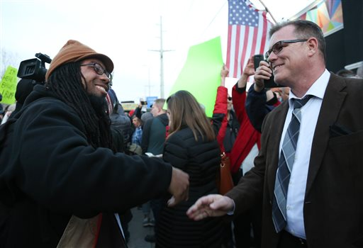"""Ricky Wilkens, left, one of the leaders of the """"Dump Trump"""" protest, speaks with a supporter of Republican presidential candidate Donald Trump outside the Infinity Events Center in Salt Lake City, where Trump held a campaign rally, Friday. Wilkens repeatedly got between arguing demonstrators and hugged or shook hands with those on the other side in an effort to diffuse tensions.Salt Lake City, Utah, March 18, 2016 