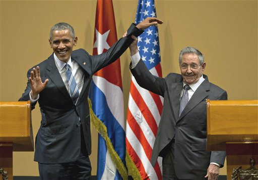 In this March 21, 2016 photo, Cuban President Raul Castro, right, lifts up the arm of President Barack Obama at the conclusion of their joint news conference at the Palace of the Revolution in Havana, Cuba. Brushing off decades of distrust, Obama and Castro shook hands, a remarkable moment for two countries working to put the bitterness of their Cold War-era enmity behind them. Havana, Cuba, March 21, 2016 | AP Photo by Ramon Espinosa, St. George News