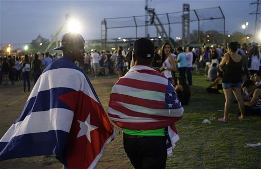 Fans carrying the Cuban and the U.S. flags draped on their backs arrive at the Ciudad Deportiva for the Rolling Stones concert in Havana, Cuba, Friday March 25, 2016 | AP Photo by Ramon Espinosa, St. George News