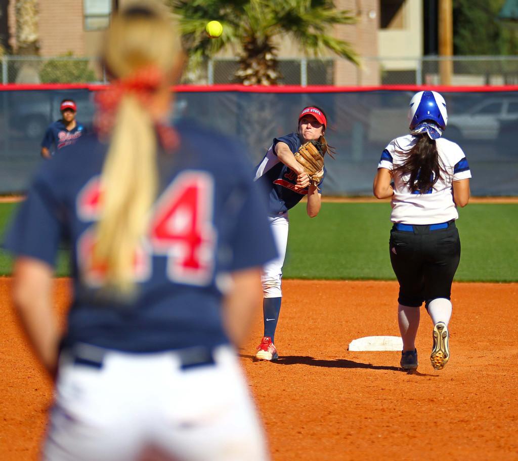 Dixie State's Dani Bartholf (2) and Mallory Paulson (24), Dixie State University vs. Chaminade University, Softball, St. George, Utah, Mar. 23, 2016, | Photo by Robert Hoppie, ASPpix.com, St. George News