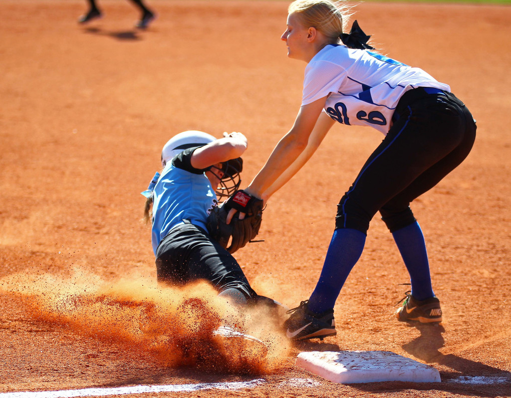Dixie's Hannah Nyberg (6) tags out Canyon View's  Avery Allen (1) at third base, Dixie vs. Canyon View, Softball, St. George, Utah, Mar. 24, 2016,   Photo by Robert Hoppie, ASPpix.com, St. George News