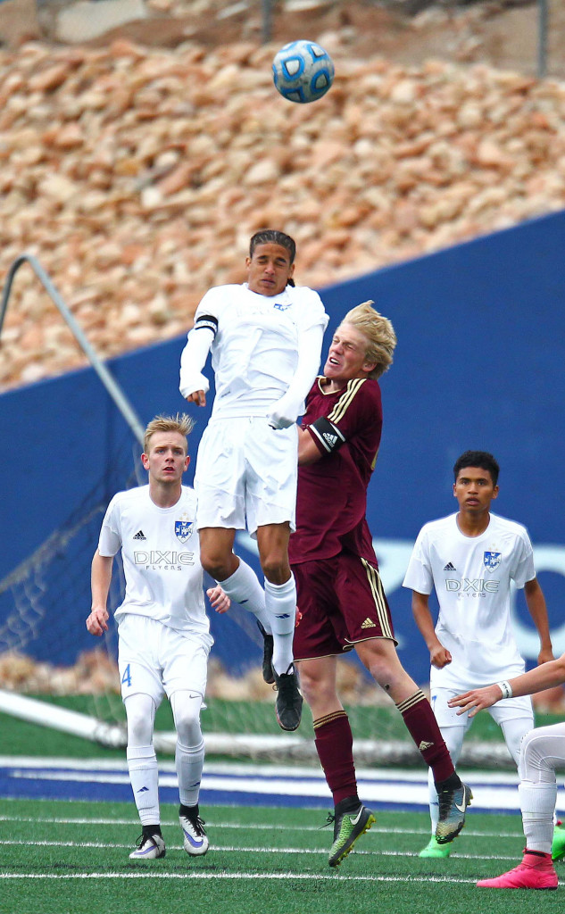 Dixie's Av'ry Green (2) and Cedar's Ethan Fletcher (20), Dixie vs. Cedar, Soccer, St. George, Utah, Mar. 29, 2016, | Photo by Robert Hoppie, ASPpix.com, St. George News