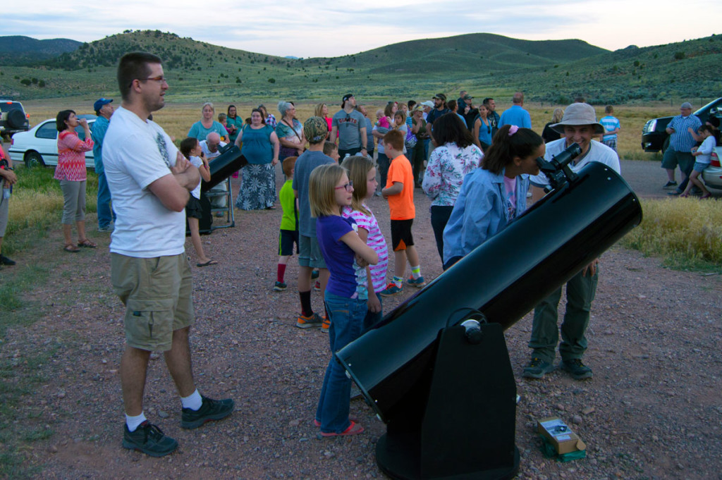 Andrew McAffee looks through the 12-inch telescope at the Solstice Event, Parowan Gap,, Utah, 2015 | Photo courtesy of Lee Ricci, St. George News
