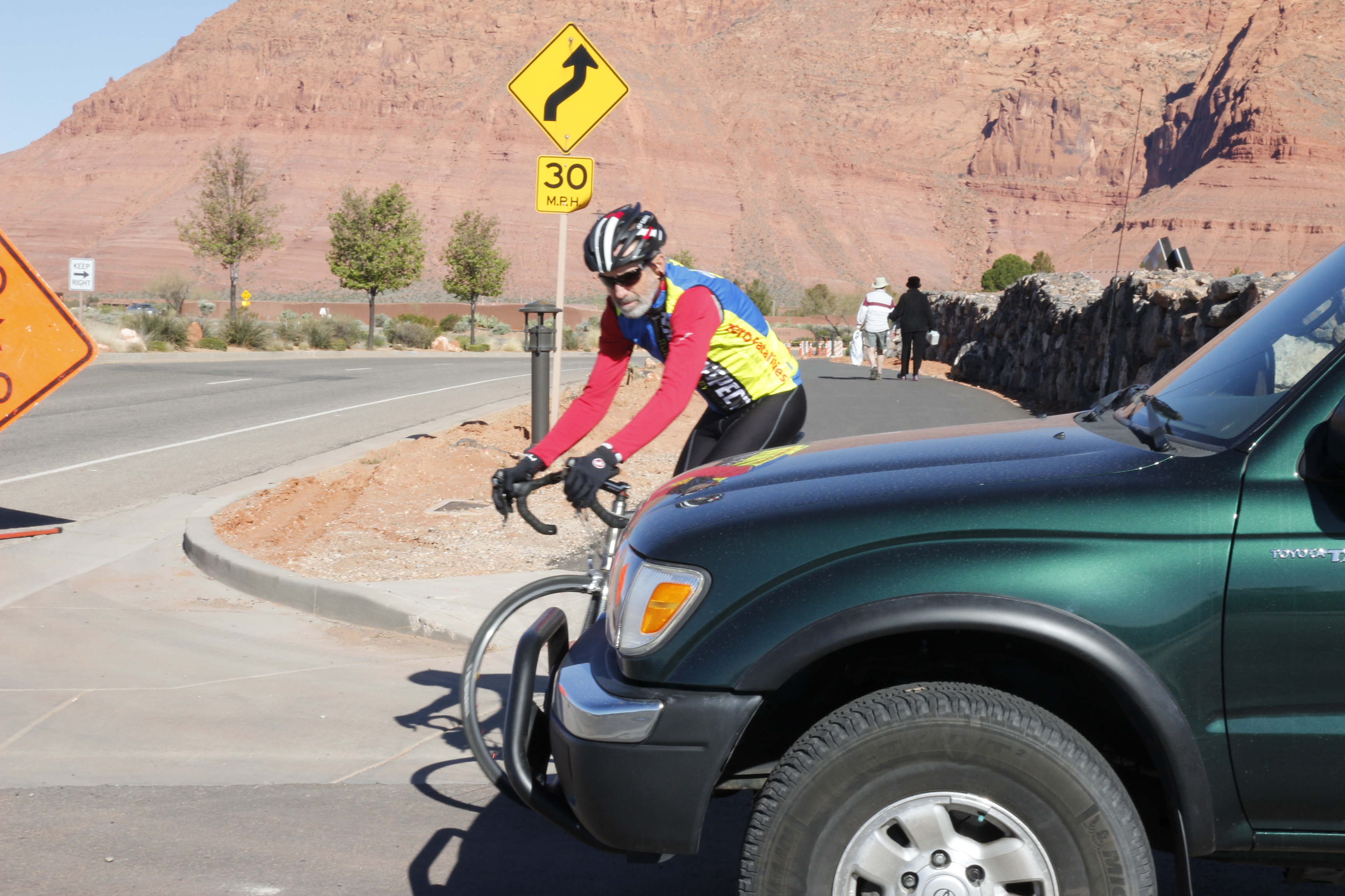 One of the most common kinds of car-bike accidents is a  collision between a motorist pulling out of a driveway or side street and a cyclist riding across it on a multiuse path or sidewalk. To prevent such an accident, motorists and cyclists should look out for the other at such intersections, establishing eye contact and clear intentions, Ivins, Utah, date not specified | Photo by Tim Tabor, St. George News