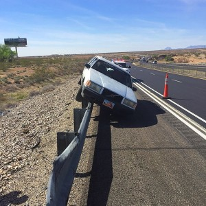 A tire blowout sent a St. George man on a wild ride that ended when the man's car came to rest on top of a guardrail along Interstate 15 near milepost 10, Desert Springs, Arizona, March 2, 2016 | Photo courtesy of Arizona Department of Public Safety, St. George News