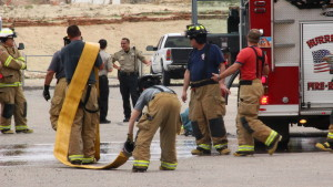 Firefighters from Hurricane Valley Fire and Rescue, Washington Fire Department and St. George Fire Department gather outside the Purgatory Correctional Facility in Hurricane after a fire started in a drier at the jail. Mar. 11, 2016 | Photo by Don Gilman, St. George News.