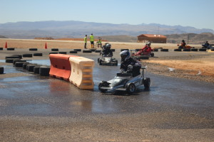 "Competitors take on the ""wet corner"" during the 16th annual SkyWest Mini Indy race in St. George, Utah, Mar. 18, 2016 
