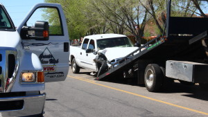 A GMC pickup truck is loaded onto a tow truck after a collision occurred at the 1150 block of West Red Hills Parkway in Washington City, Utah, March 23, 2016 | Photo by Don Gilman, St. George News