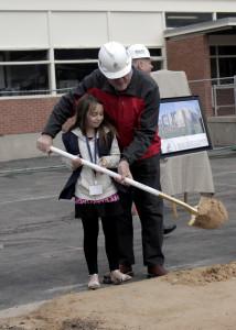 Cedar City Councilman invites a student to help turn the sand, Cedar North Elementary, Cedar City, Utah, March 23, 2016 | Photo by Carin Miller, St. George News
