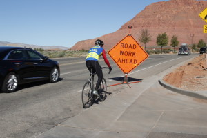 Roads have many hazards for motorists and cyclists alike. When seeking a safe opportunity to pass a cyclist, a motorist must, by law, allow at least three feet. Providing more than three feet when passing, if it is safe to do so, will allow the cyclist to move into the roadway to avoid an upcoming road hazard, Date and location not given | Photo by Tim Tabor, St. George News