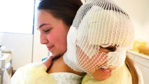 Sister Fanny Rachel Clain, a Mormon missionary who was injured in one of the March 22 bombings in Brussels, gets a visit in the hospital from her former missionary companion, Sister Haylie VanDenBerghe| Photo courtesy of LDS Newsroom, St. George News