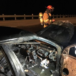 Flames engulfed a vehicle along southbound Interstate 15 milepost 35, Washington County, Utah, March 21, 2016 | Photo by Michael Durrant, St. George News