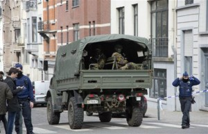 A truck carrying soldiers of the Belgian Army arrives after an explosion in a main metro station in Brussels on Tuesday, March 22, 2016. Explosions rocked the Brussels airport and the subway system Tuesday, killing at least 13 people and injuring many others just days after the main suspect in the November Paris attacks was arrested in the city, police said, Brussels, Belgium, March 22, 2016. | AP Photo/Geert Vanden Wijngaert, St. George News
