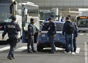 Police officers perform security checks at Fiumicino airport, near Rome, Tuesday, March 22, 2016. The Italian Interior Ministry announced heightened security measures at major Italian airports following explosions at the Brussels airport and the subway system earlier Tuesday, Brussels, Belgium, March 22, 2016.   Photo by Telenews/ANSA via AP, ITALY OUT, St. George News