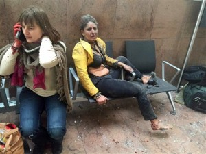 In this photo provided by Georgian Public Broadcaster and photographed by Ketevan Kardava two women wounded in Brussels Airport. A developing situation left at least one person and possibly more dead in explosions that ripped through the departure hall at Brussels airport Tuesday, police said. All flights were canceled, arriving planes were being diverted and Belgium's terror alert level was raised to maximum, officials said, Brussels, Belgium, March 22, 2016 | Photo by Ketevan Kardava/ Georgian Public Broadcaster via AP, St. George News