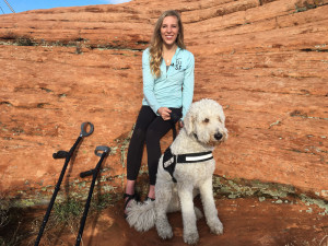 Brittany Fisher arrives with her companion dog, a golden doodle, Cooper, at Cougar Cliffs. Fisher suffered serious injuries when she fell from the rocks while there on a rappelling excursion March 12, 2012. Four years later she returned to rappel the cliffs again with the help of the high angle rope rescue team. Cougar Cliffs area of Washington County, Utah, March 12, 2016 | Photo by Rick Graf, St. George News