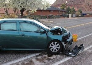 A car missed a curve and hit a pillar in front of a Bloomington home Monday evening. St. George, Utah, March 7, 2016 | Photo by Ric Wayman, St. George News