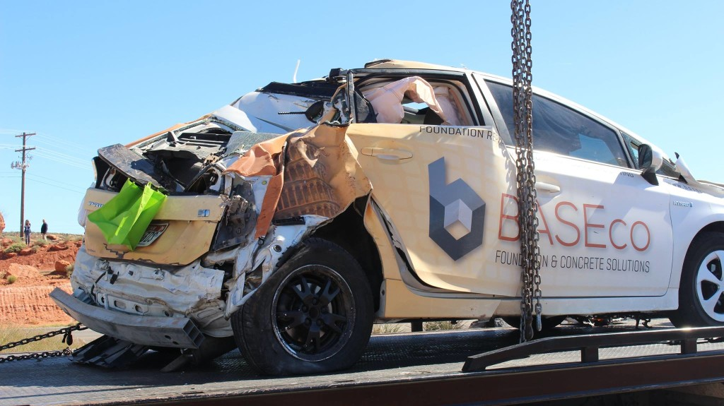 An Electric Car Is Lifted From A Ravine After It Rolled 75 Feet Down Parking Lot Near Pioneer Park St George Utah March 23 2016 Photo By Don