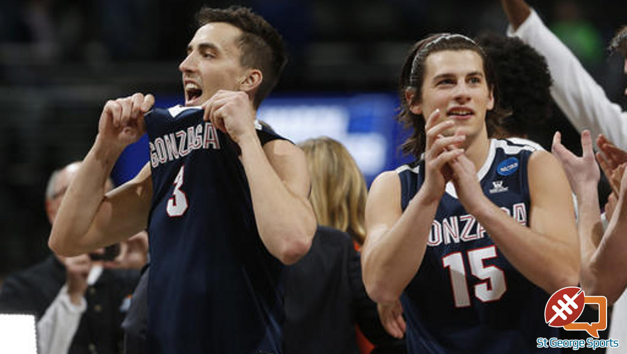 Gonzaga guards Kyle Dranginis, left, and Rem Bakamus celebrate at the end of a second-round men's college basketball game against Utah on Saturday, March 19, 2016, in the NCAA Tournament in Denver. Gonzaga won 82-59. (AP Photo/David Zalubowski)
