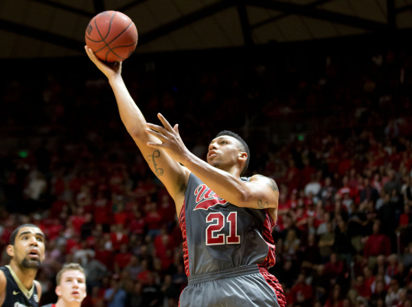 Utah Utes forward Jordan Loveridge (21) puts up a shot during the second half against the Colorado Buffaloes at Jon M. Huntsman Center. Utah won 57-55. Mandatory Credit: Russ Isabella-USA TODAY Sports