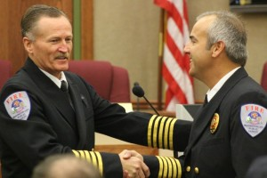 Retiring Washington City Fire Chief Brent Hafen (left) shaking hands with his successor, new Fire Chief Matt Evans, Washington City, Utah, March 28, 2015 | Photo by St. George News