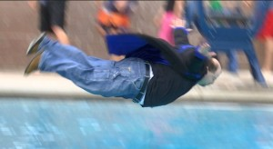St. George News senior reporter Mori Kessler flies through the air on his way to a perfect belly flop Saturday in this year's Special Olympics Polar Plunge. St. George, Utah, March 5, 2016 | Photo by Sheldon Demke, St. George News