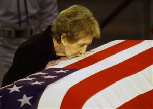 FILE -Former first lady Nancy Reagan kisses the casket of her husband former President Ronald Reagan prior to the removal of his remains from the Capitol Rotunda in Washington. The former first lady has died at 94, The Associated Press confirmed. Simi Valley, California, June 11, 2004   Photo by Elise Amendola, Associated Press, St. George News