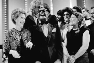 FILE -First lady Nancy Reagan, left, gets a laugh with Ray Charles, center, and Willie Nelson, right, and other entertainers at a salute to country music at Constitution Hall in Washington. The former first lady has died at 94, The Associated Press confirmed. Washington, D.C., March 16, 1983   Photo by Ira Schwarz, Associated Press, St. George News