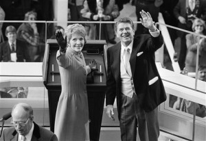 FILE - President Ronald Reagan and first lady Nancy Reagan wave to onlookers at the Capitol building as they stand at the podium in Washington following the presidential swearing in ceremony. The former first lady has died at 94, The Associated Press confirmed. Washington, D.C., Jan. 20, 1981   Photo courtesy of Associated Press, St. George News