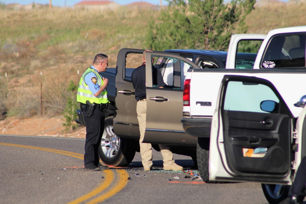 Officers tending to scene after head on collision on Pioneer Road, St. George, Utah, Mar. 24, 2016| Photo by Cody Blowers, St. George News