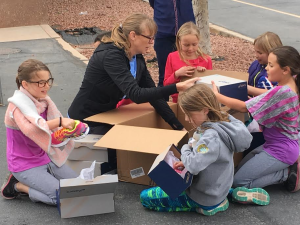 Girls on the Run of Southern Utah executive director, Melissa Miller, surprises participants of the program with new shoes at Arrowhead Elementary, Santa Clara, Utah, March 29, 2016   Photo by Hollie Reina, St. George News