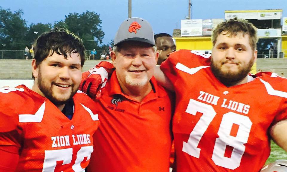 Dr. Dale Stott (center) returns as coach and owner of the Zion Lions, along with his sons Trevor (L, center/long snapper) and Logan (R, right tackle).