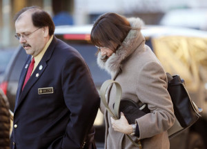 New Hampshire state Rep. Susan DeLemus, right, leaves the Federal Courthouse with state Rep. John Burt after attending a hearing for her husband Gerald DeLemus Thursday March, 3, 2016 in Concord, N.H. DeLemus of Rochester, N.H. was arrested on allegations that he organized and led armed patrols and security checkpoints for several weeks after a tense armed confrontation in April 2014 near Cliven Bundy's melon farm and cattle ranch in Bunkerville, Nevada. (AP Photo/Jim Cole)