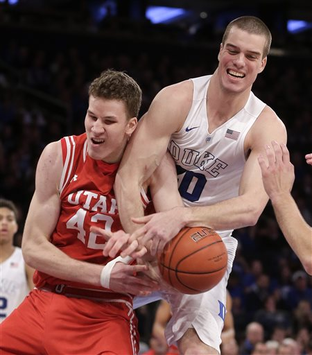 Utah forward Jakob Poeltl (42) battles for a rebound against Duke center Marshall Plumlee (40) in the second half of an NCAA college basketball game, Saturday, Dec. 19, 2015, in New York. Utah won 77-75. (AP Photo/Julie Jacobson)